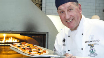 Picture - Ken Macpherson, Inverness See Alasdair Fraser story. Inverness CT manager Terry Butcher tried his hand at pizza making in Zizzi's Restaurant, Inverness, yesterday (Tues) as he launched a chance for fans to 'win a slice of the action' in the launch of the club's new away strip later this year. Fans will have the chance to win a trip to Parma in Italy in April to witness the new strip coming off the production line there.