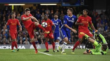Britain Football Soccer - Chelsea v Liverpool - Premier League - Stamford Bridge - 16/9/16 Liverpool's James Milner clears Reuters / Dylan Martinez Livepic